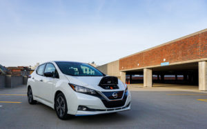 2020 Nissan Leaf SL Plus front-quarter view with charge door open.